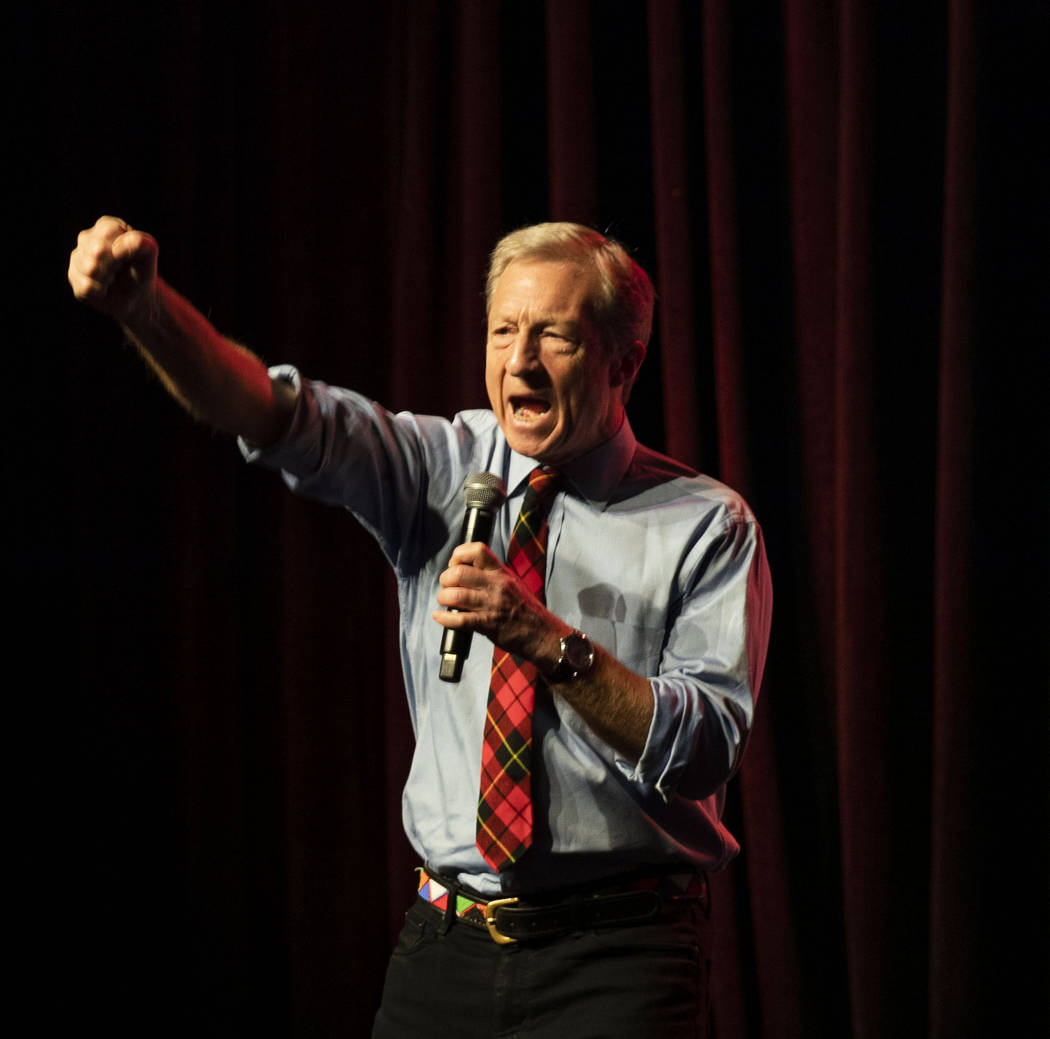 """Democratic presidential candidate Tom Steyer leads a chant stating """"we demand justice,&quo ..."""