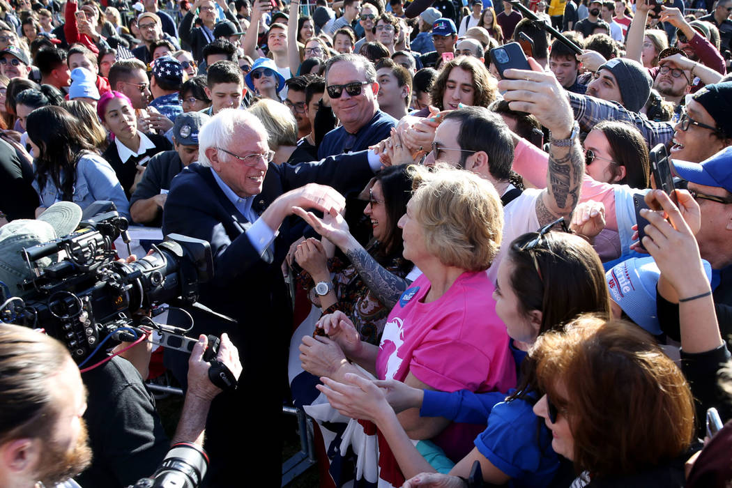 Vermont Sen. Bernie Sanders shakes hands with supporters during a Get Out the Early Vote Rally ...