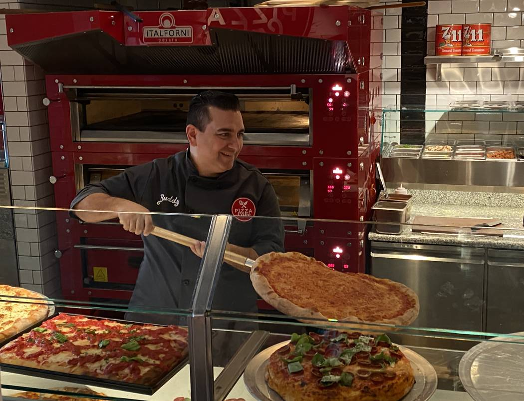 Buddy Valastro takes a pizza out of the oven at PizzaCake (Al Mancini/Las vegas Review-Journal)