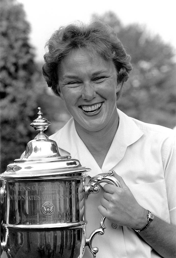 Mickey Wright poses after winning her third Women's National Open golf championship, at the Bal ...