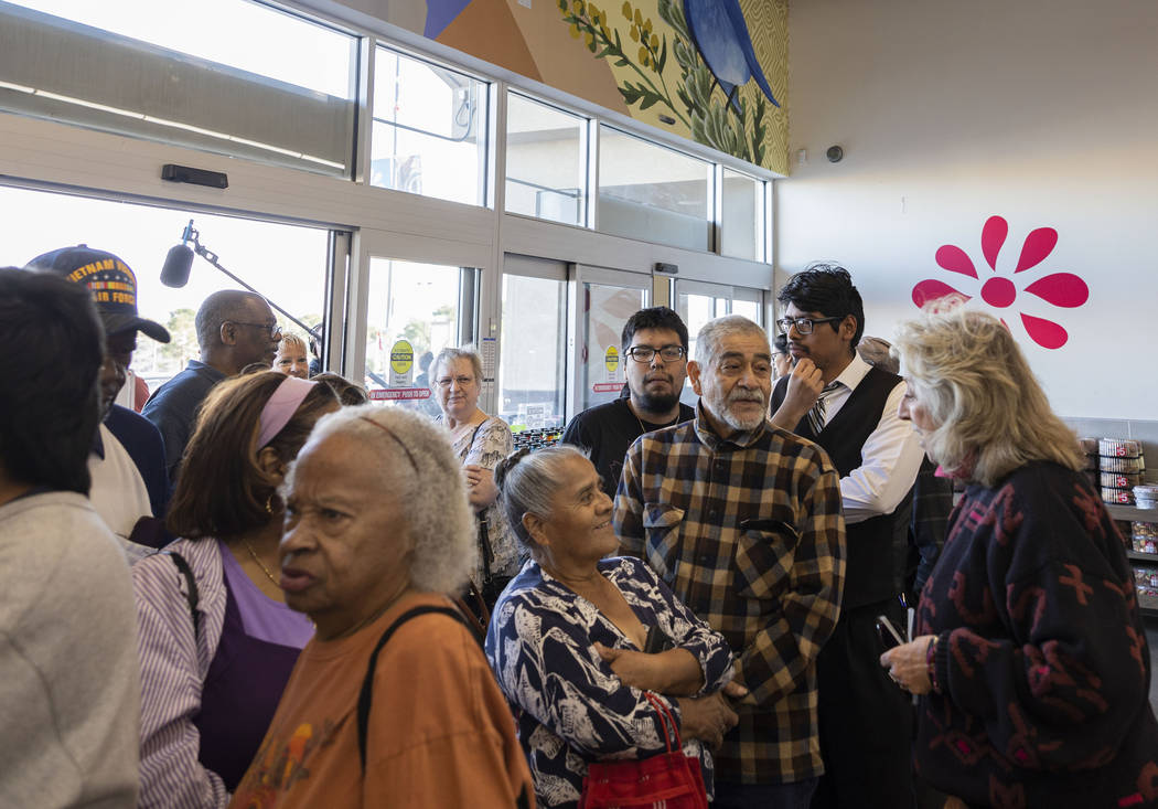 Rep. Dina Titus, D-Nev., greets people as they wait in line to cast their early vote at Cardena ...
