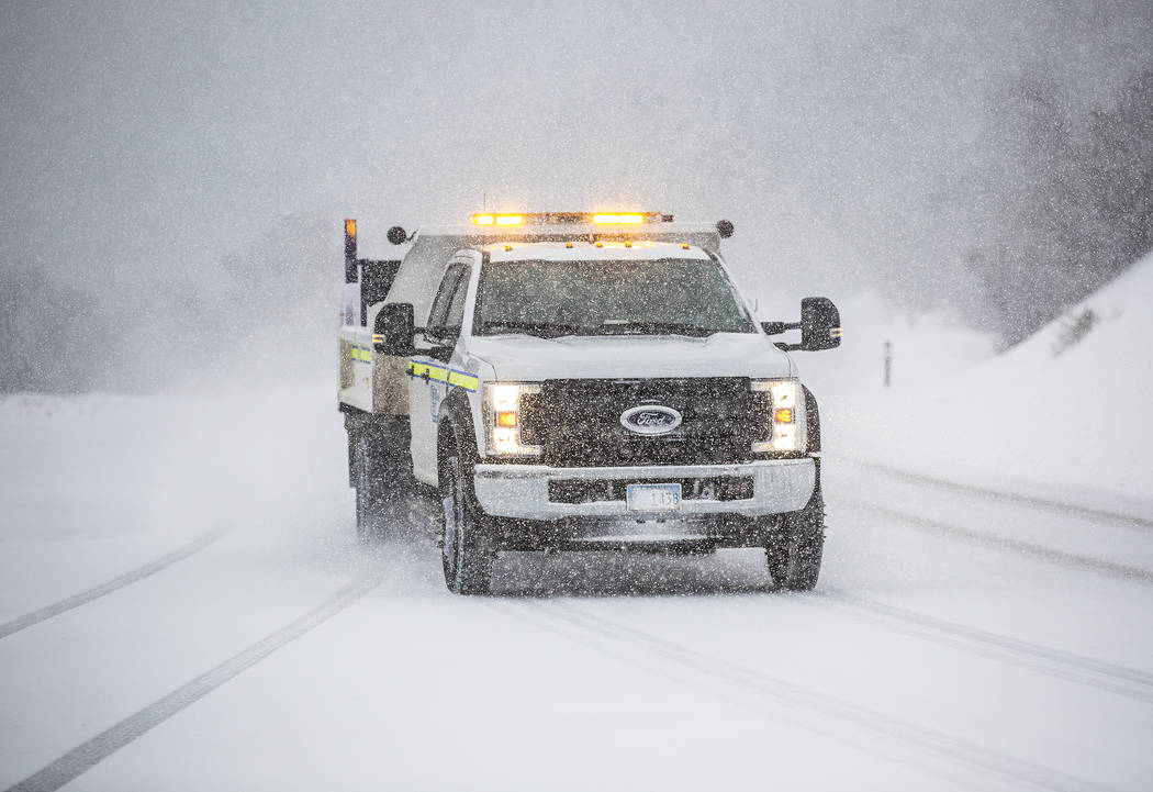 A Nevada Department of Transportation vehicle drives in heavy snow at Mount Charleston on Wedne ...
