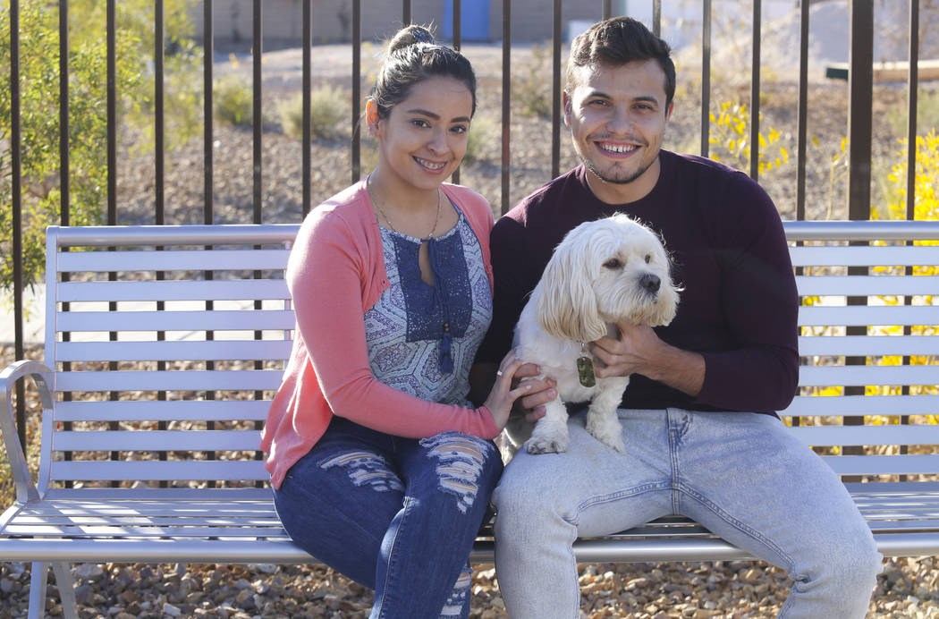 Sandra Llonttop and Ion Mereuta with their dog, Sparky, are starting their new lives together i ...