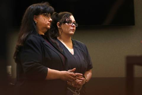Cassie Smith, right, charged in the death of her 3-year-old son, Daniel Theriot, listens during ...
