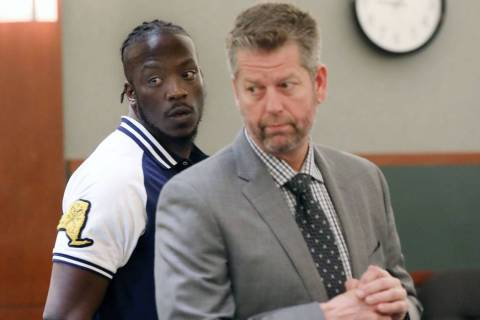 Durwin Allen, left, appears in court to set a new trial date with attorney Peter S. Christianse ...