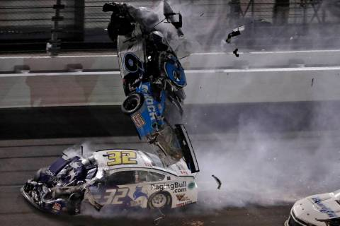 Ryan Newman (6) goes airborne after crashing into Corey LaJoie (32) during the NASCAR Daytona 5 ...