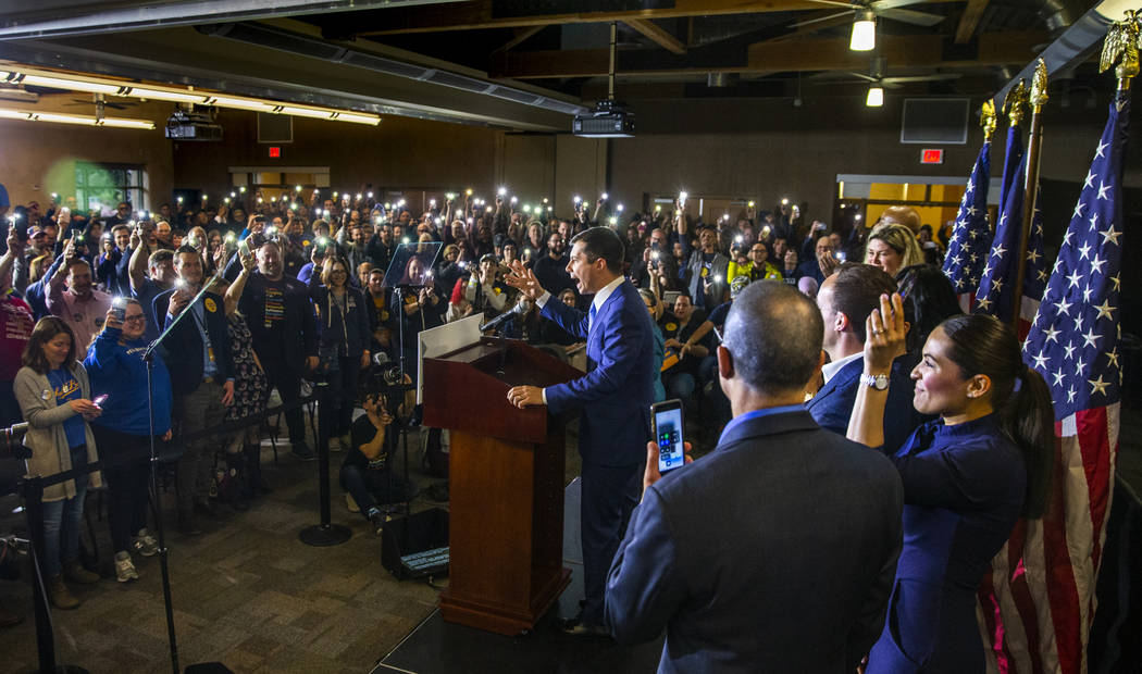 Members of the crowd hold up their lit phones in support as Democratic presidential candidate a ...