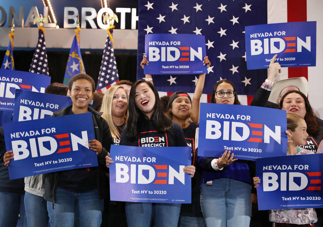 Supporters chant for presidential candidate former Vice President Joe Biden speaks during a cau ...
