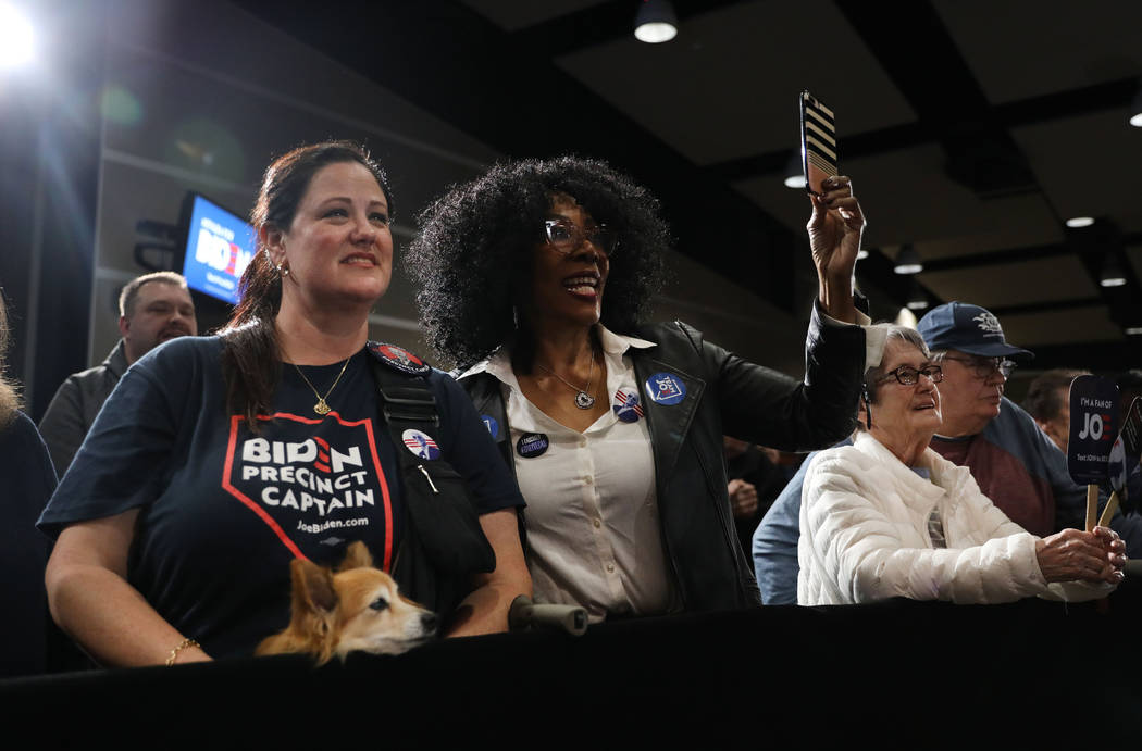 Supporters cheer for presidential candidate former Vice President Joe Biden speaks during a cau ...