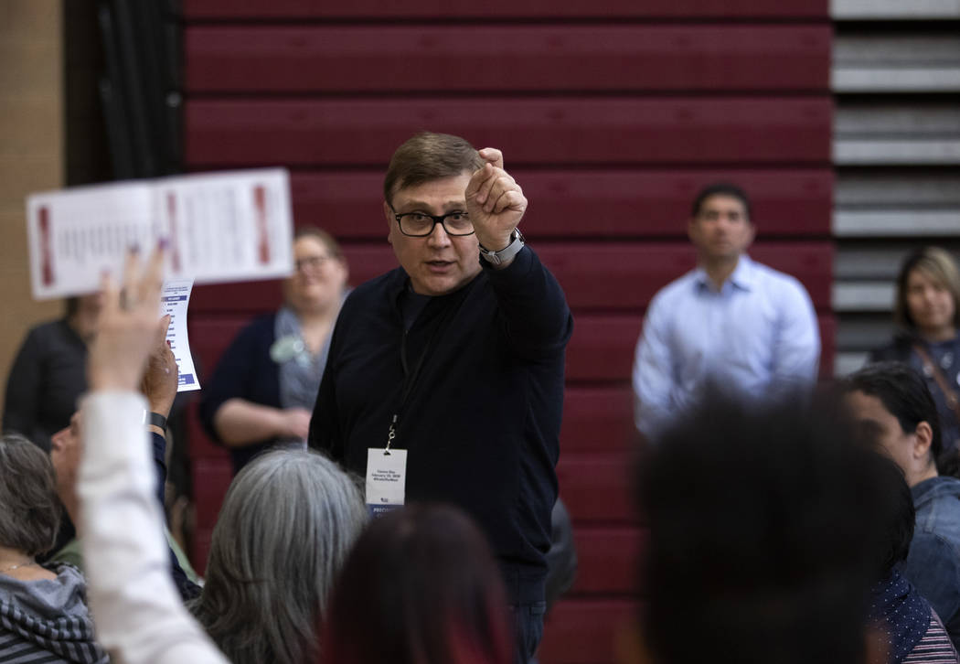 A precinct captain counts ballots at the Nevada caucus at Desert Oasis High School on Saturday, ...