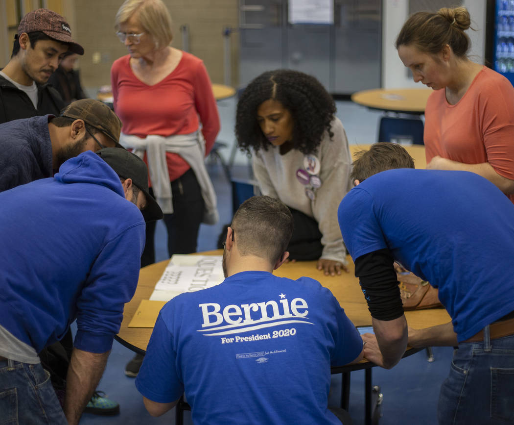 A group of Bernie Sanders supporters calculates ballots for their group during the Nevada caucu ...