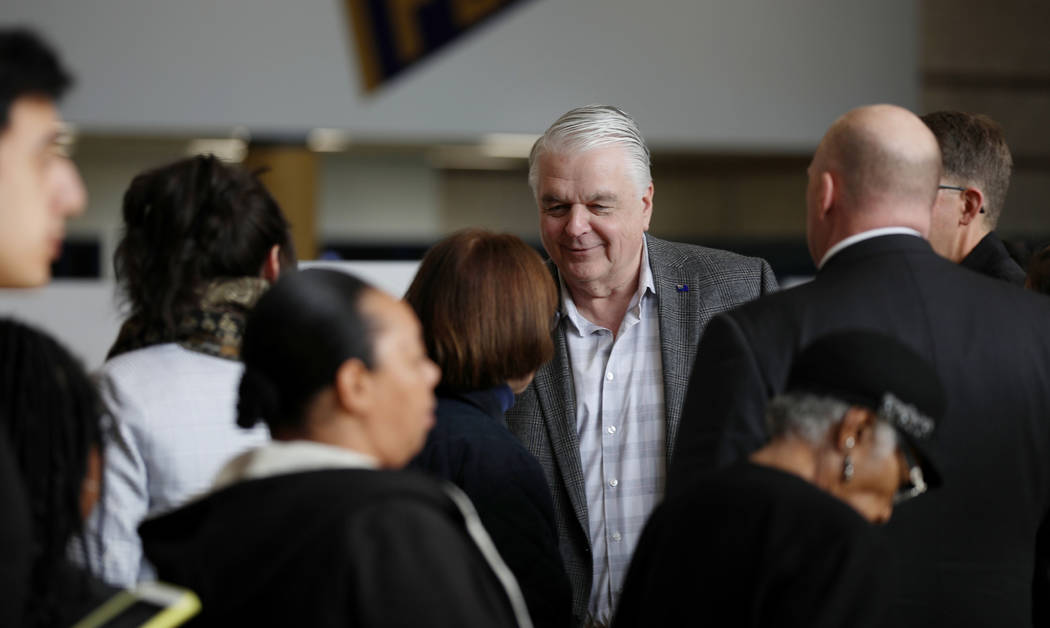 Nevada Governor Steve Sisolak greets caucus participants at Cheyenne High School in North Las V ...