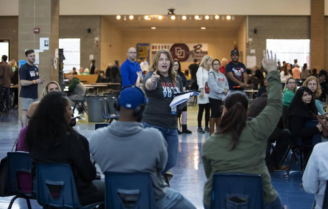 Precinct chair Kim Rogers counts hands for Sen. Elizabeth Warren during the Nevada caucus at De ...