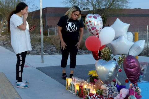 Melany Romero, 11, reacts with her mother Ana Romero Monday, Feb. 17, 2020, at a memorial in th ...