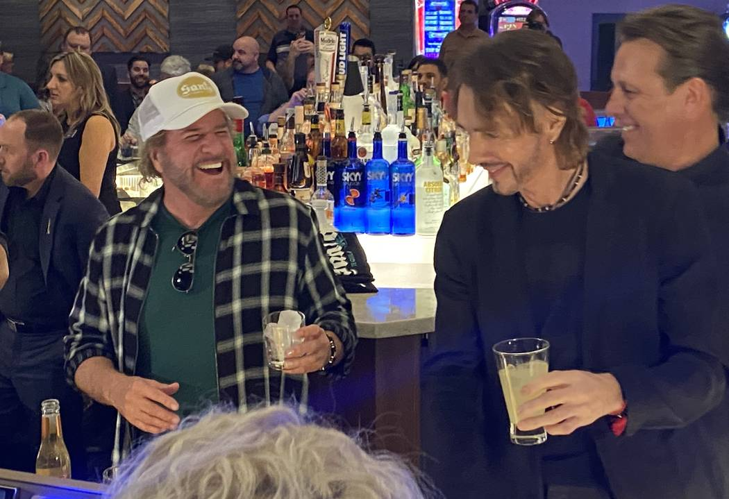 Sammy Hagar, left, and Rick Springfield tend bar at The Strat Hotel on Wednesday, Jan. 22, 2020 ...