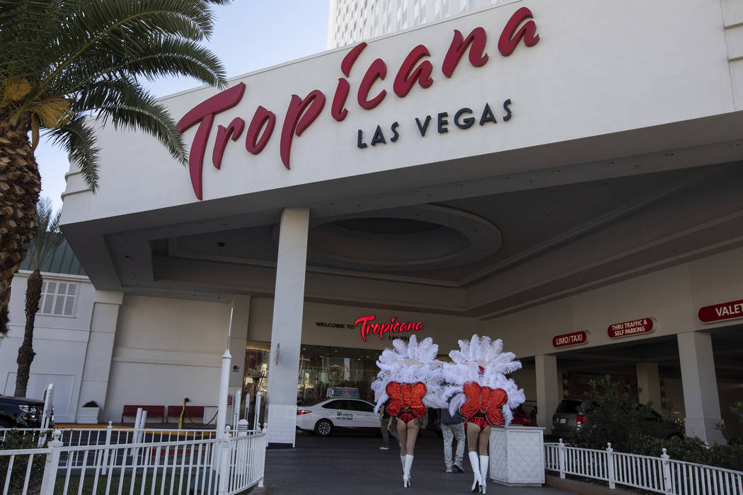 Show girls walk outside of Tropicana on Wednesday, Feb. 19, 2020, in Las Vegas. Investors have ...