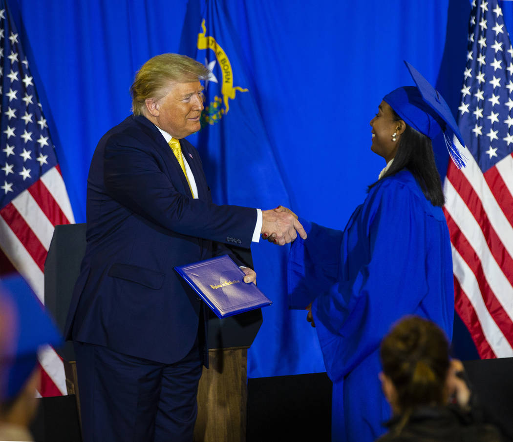 President Donald Trump hands out diplomas during a graduation ceremony for participants of the ...