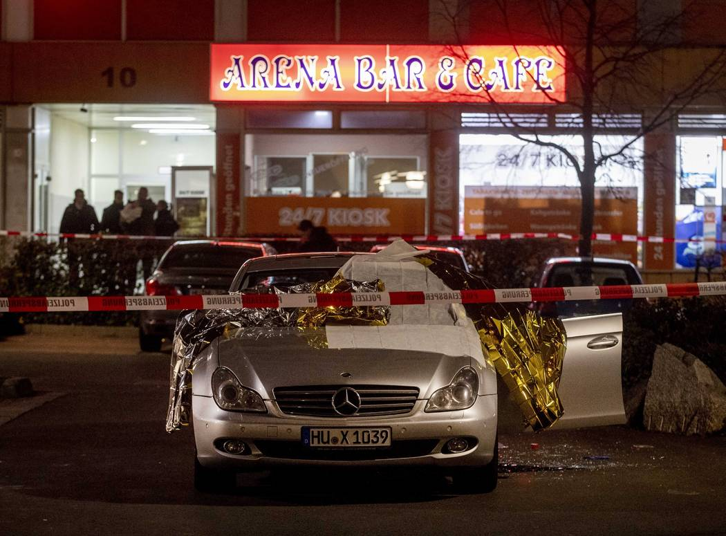 A car with dead bodies stands in front of a bar in Hanau, Germany, Thursday, Feb. 20, 2020. Ger ...