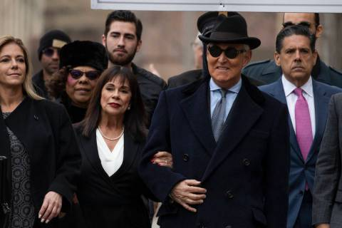Roger Stone with accompanied by his wife Nydia Stone, second from left, arrives at federal cour ...