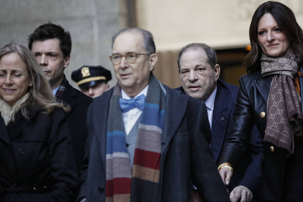 Harvey Weinstein, second right, leaves a Manhattan courthouse during his rape trial, Wednesday, ...