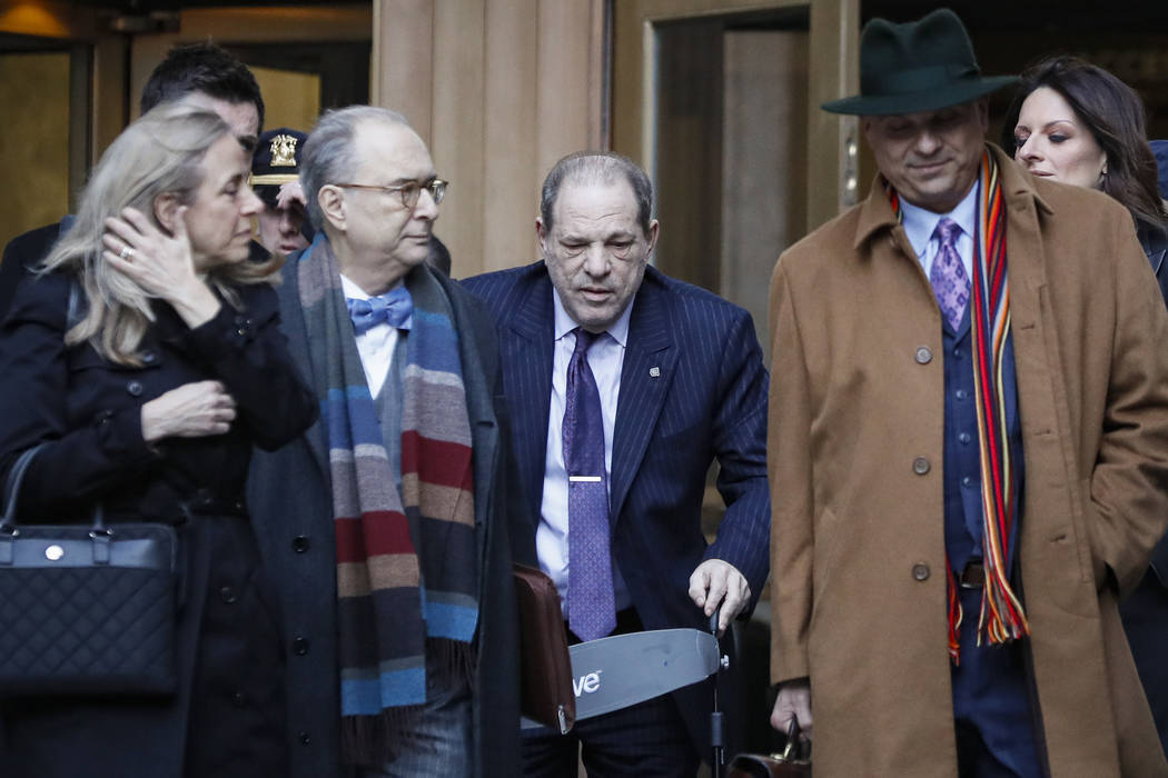 Harvey Weinstein, center, leaves a Manhattan courthouse during his rape trial, Wednesday, Feb. ...