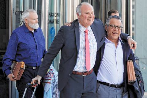 Defendant James Gillespie, left, attorney Michael Kennedy, center, and defendant Ernesto Gonzal ...