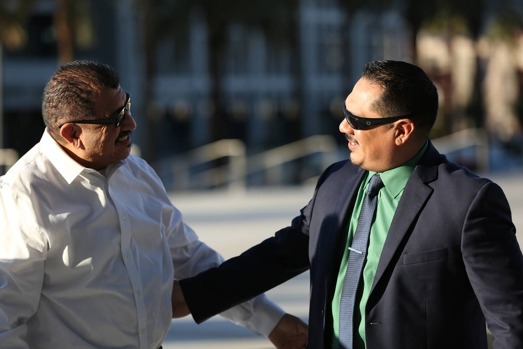 Pastor Palafox, left, greets Albert Lopez outside the federal courthouse in Las Vegas after the ...