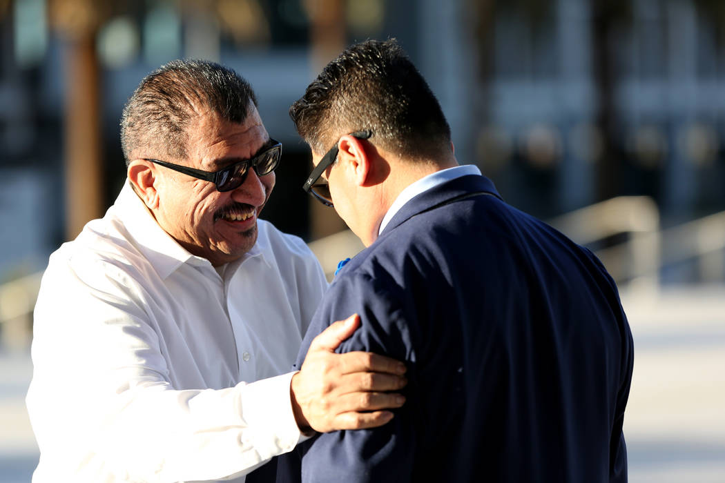 Pastor Palafox, left, greets Bradley Campos outside the federal courthouse in Las Vegas after t ...
