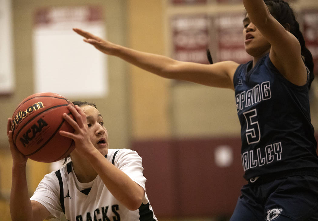 Desert Oasis's Isabella Jaramillo (2) looks to pass to a teammate as Spring Valley's Chelsea Ca ...