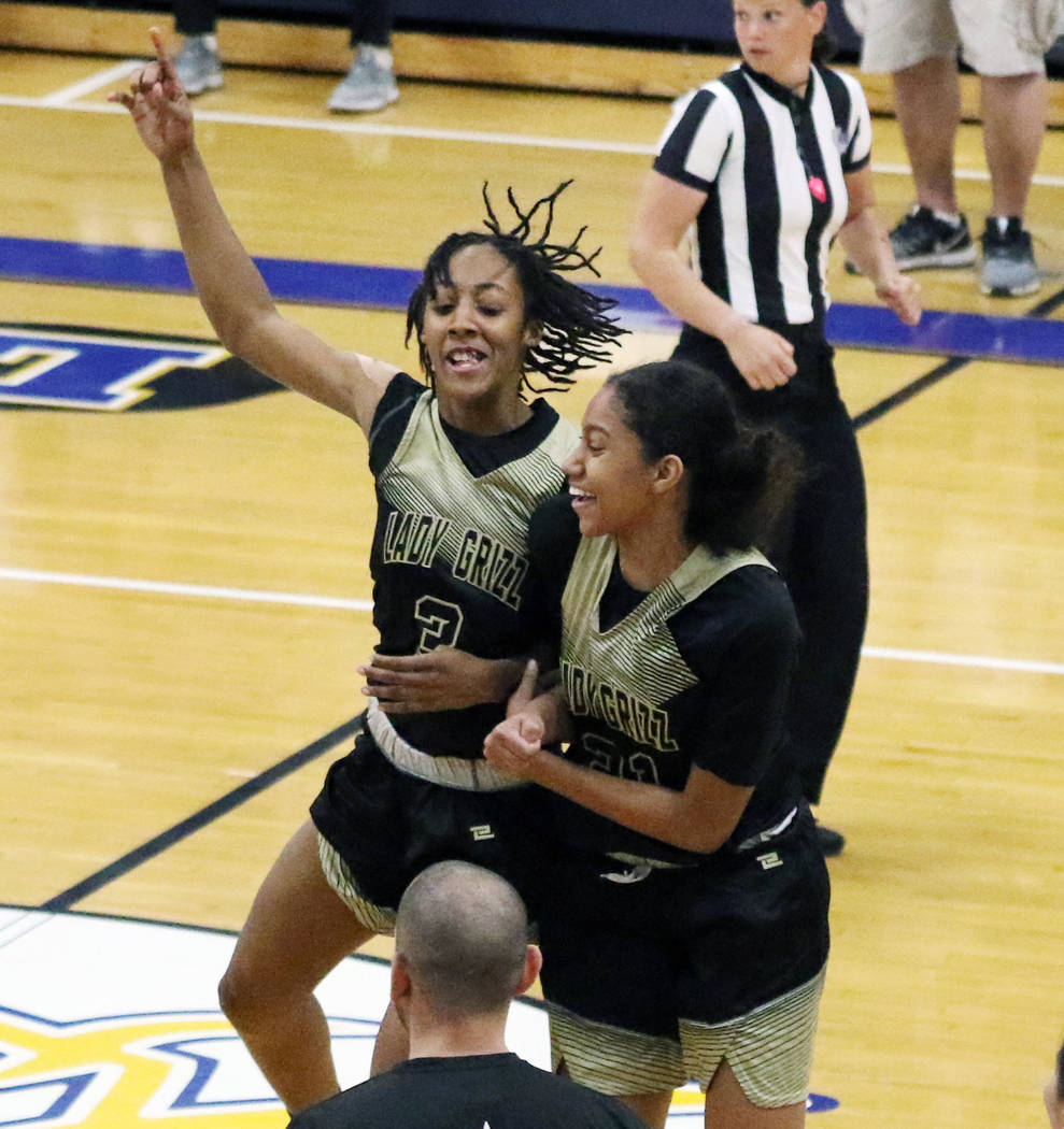 Spring Valley's Aaliyah Gayles (3) and Kylah Collins (21) celebrate after winning their first-r ...