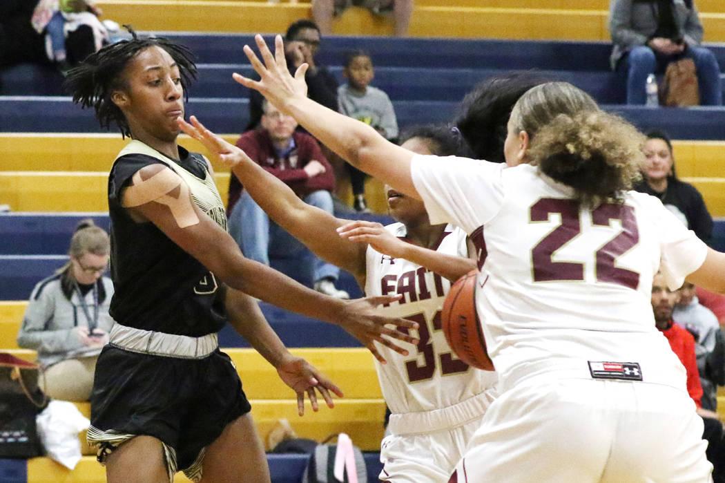 Spring Valley's Aaliyah Gayles (3) passes the ball between Faith Lutheran's Skye Chapman landa ...