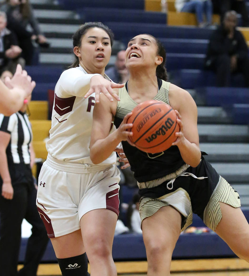Faith Lutheran's Jalen Tanuvasa, left, defends Spring Valley's Kiana Turenne during the second ...