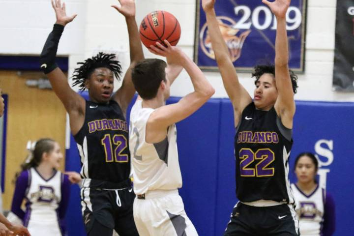 Durango High's Sebastian Mack (12) and Sterling Knox (22) defend Faith Lutheran's Max Heinz (22 ...