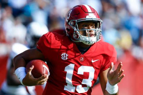 Alabama quarterback Tua Tagovailoa (13) carries the ball during the first half of an NCAA colle ...