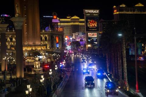 President Donald Trump, bottom/left, drives north on the Strip outside The Venetian with a ...