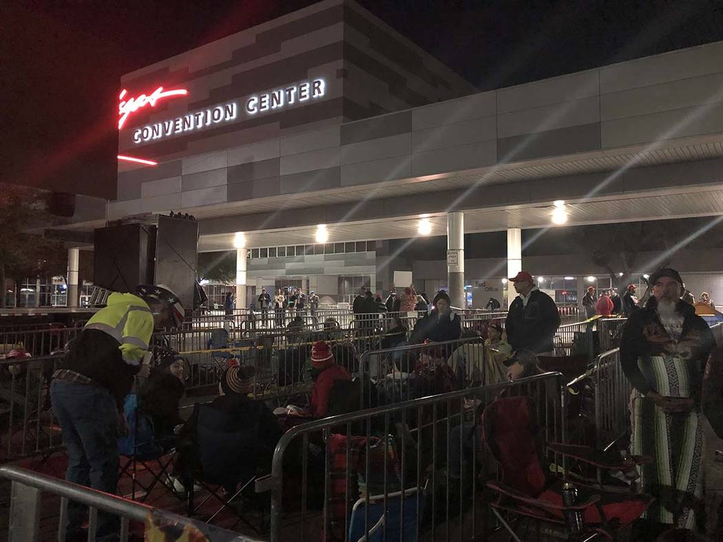 A crowd camps outside the Las Vegas Convention Center on Thursday, Feb. 20, 2020, where Preside ...