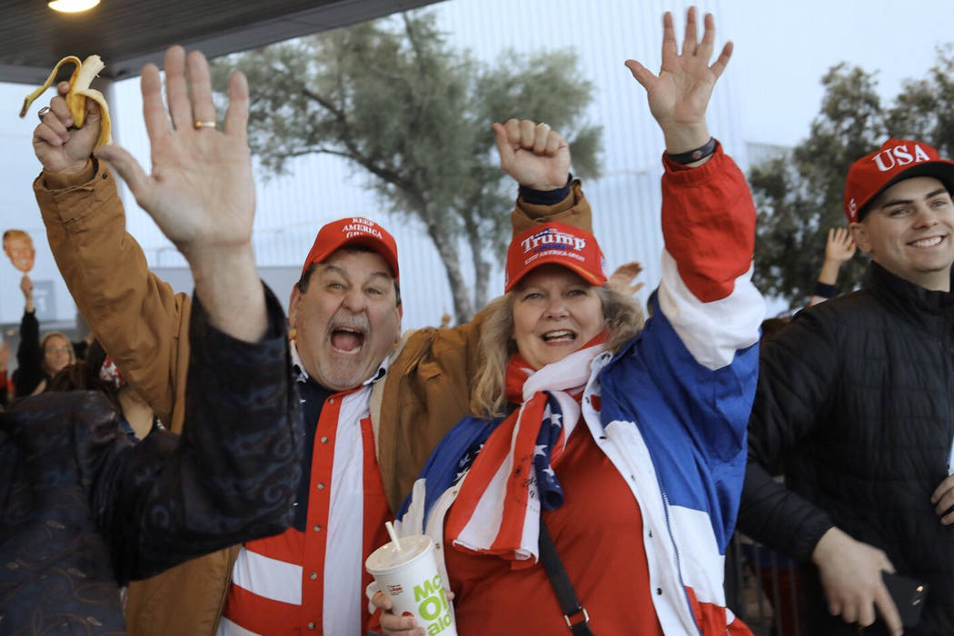 Don and Denise DeRosa, of El Dorado, Calif., cheer for President Trump before a campaign rally ...