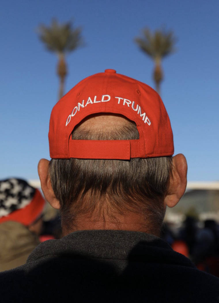 A President Tump supporter waits in line before a campaign rally Friday, Feb. 21, 2020, in Las ...