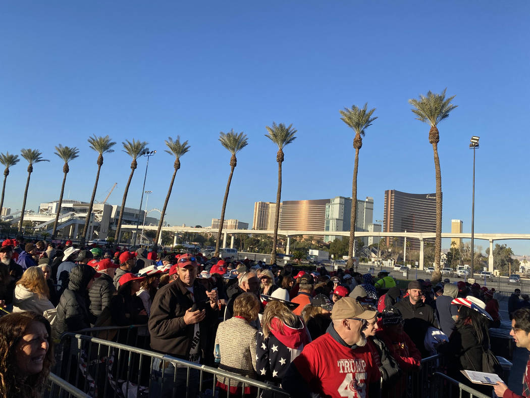 A long line of people wait Friday, Feb. 21, 2020, to gain entrance to the Las Vegas Convention ...