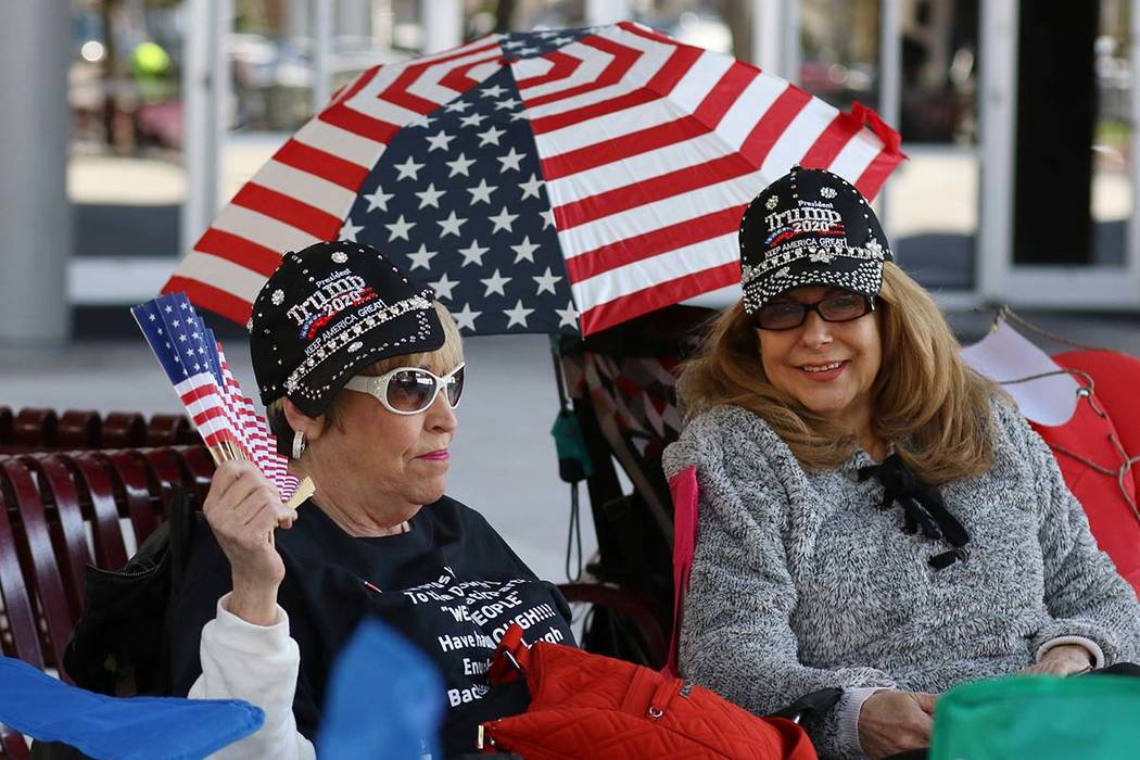 Lynn Kaplan, left, and Nancy Curtin, both of Las Vegas, camp outside the Las Vegas Convention C ...