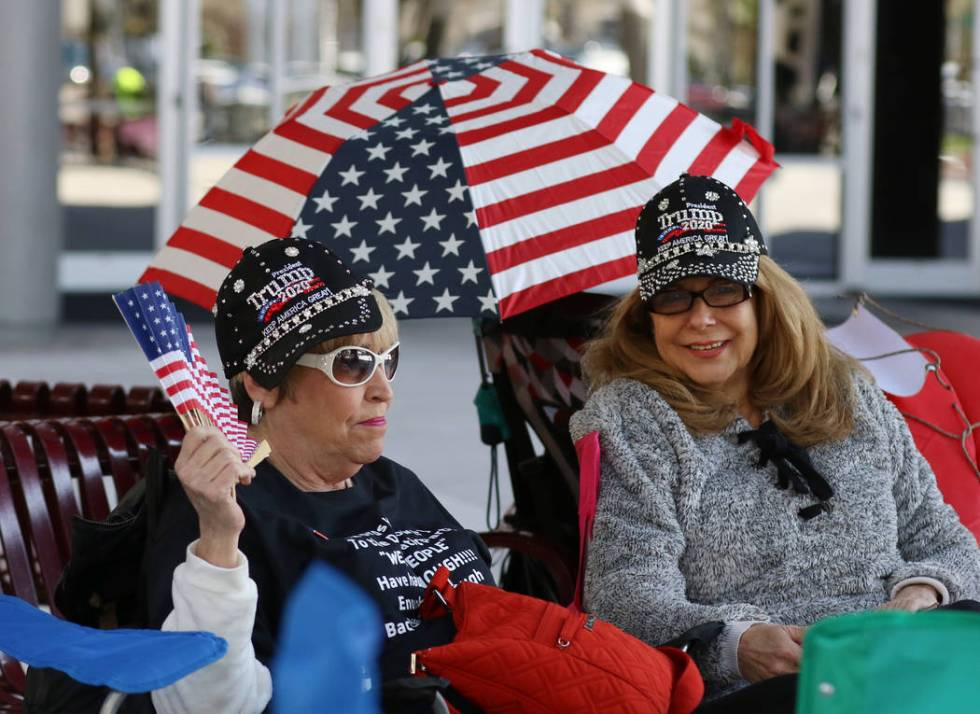 Lynn Caplan, left, and Nancy Curtin, both of Las Vegas, camp outside the Las Vegas Convention C ...