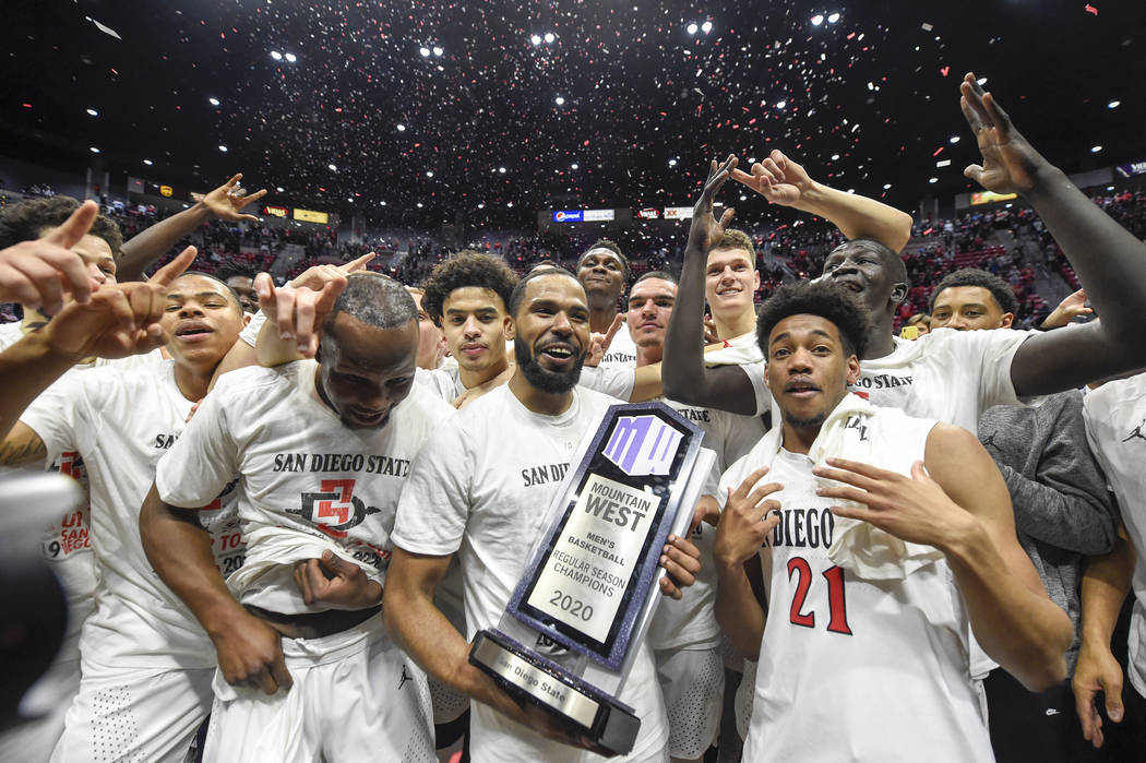 San Diego State players celebrate after beating New Mexico 82-59 in an NCAA college basketball ...