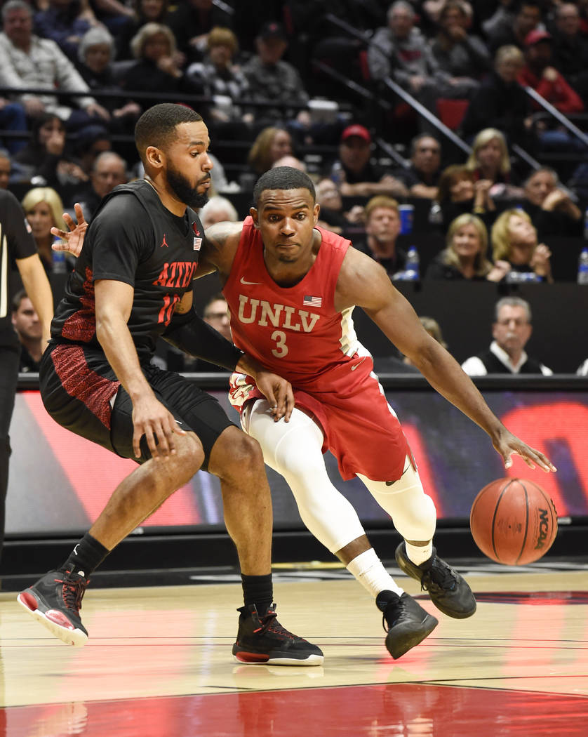 UNLV guard Amauri Hardy (3) drives past San Diego State guard KJ Feagin (10) during the first h ...