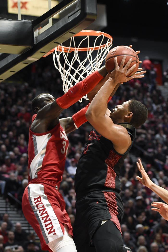 San Diego State forward Matt Mitchell, right, is fouled by UNLV forward Cheikh Mbacke Diong (34 ...