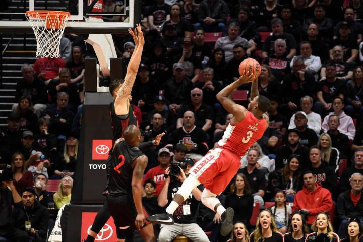 UNLV guard Amauri Hardy (3) shoots over San Diego State forward Nolan Narain (12) during the fi ...