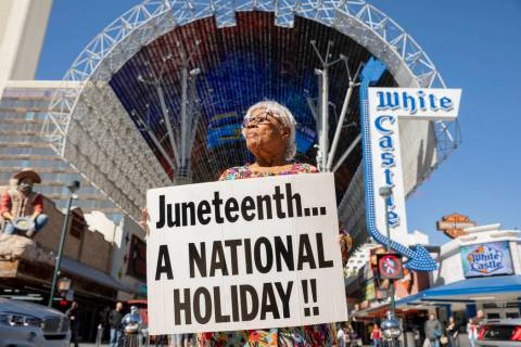 Opal Lee, 93, of Fort Worth, Texas, holds a sign on the Fremont Street Experience as part of a ...