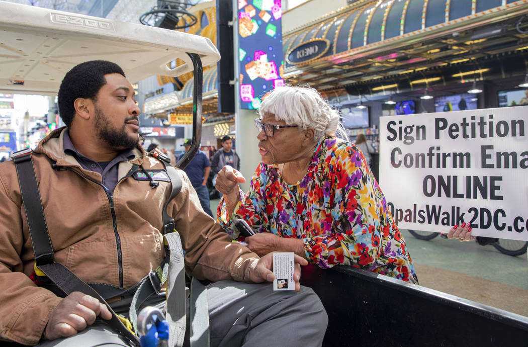 Opal Lee, 93, of Fort Worth, Texas, talks with Shamar Henderson, of Las Vegas, while walking th ...