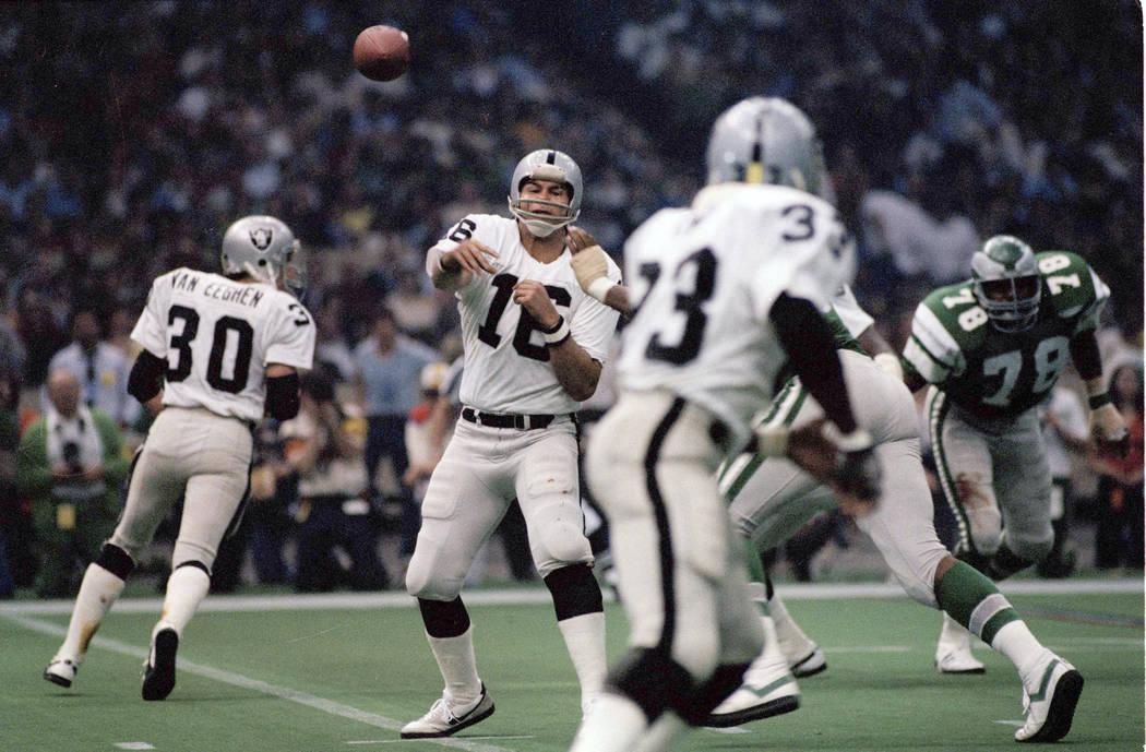 In this Jan. 25, 1981, Oakland Raiders quarterback Jim Plunkett (16) throws during NFL football ...