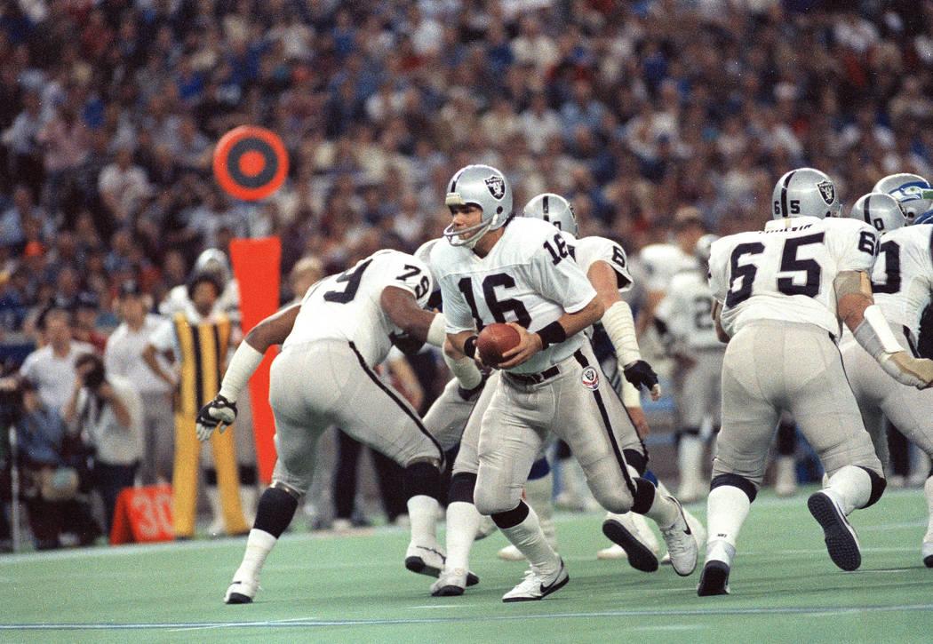 Los Angeles Raiders quarterback Jim Plunkett (16) in action against the Seahawks in Seattle, De ...