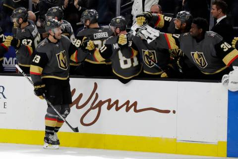 Vegas Golden Knights defenseman Alec Martinez (23) celebrates after scoring against the Tampa B ...